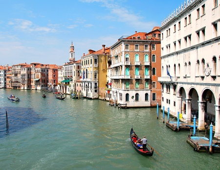 Gondolas pass main canal at Venice in Italy. photo