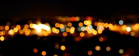 Photo of glittering lights in night city.  Stock Photo