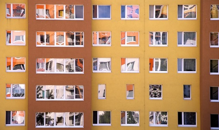 apartment blocks: Detail image of a lot of windows in prefab. Stock Photo