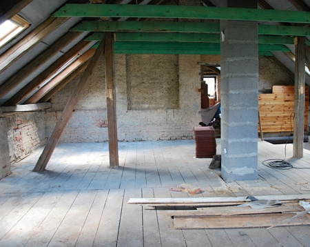 Photo of attic construction in cottage.
