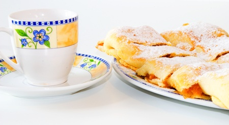 strudel: Apple strudel with cup of tea Stock Photo