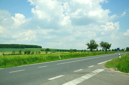 Crossroad in the middle of fields. Stock Photo - 9574394
