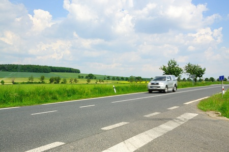 Crossroad in the middle of fields with car. Stock Photo - 9574393