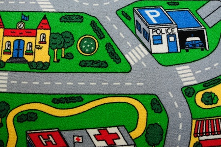 Alfombra infantil con carreteras y edificios. Foto de archivo - 9667500