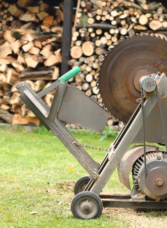 woodshed: Circular saw with woodshed in background.