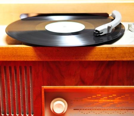Closeup view at retro vinyl wood gramophone. photo