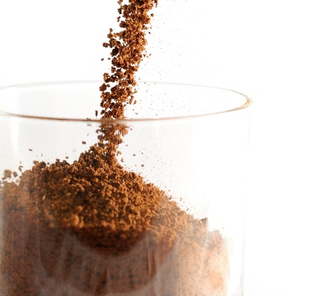 Closeup image of pouring brown instant coffee to the glass. 스톡 콘텐츠