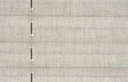 Closeup image of gray fabric blind on the window  photo