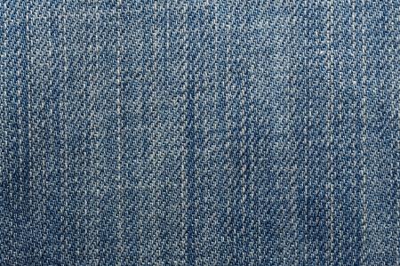 ブルー ジーンズのシームレスな背景のマクロ撮影