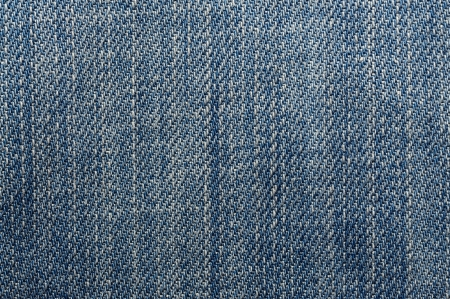 Macro shoot of blue jeans seamless background  photo