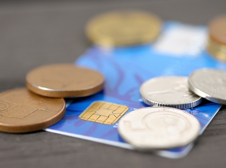bankcard: Macro shot of old blue credit card with Czech coins  crown   Stock Photo