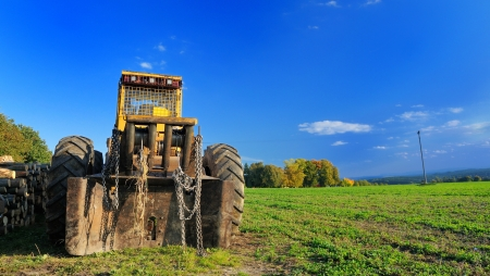 Old yellow digger parked on the field  Stock Photo - 15661309