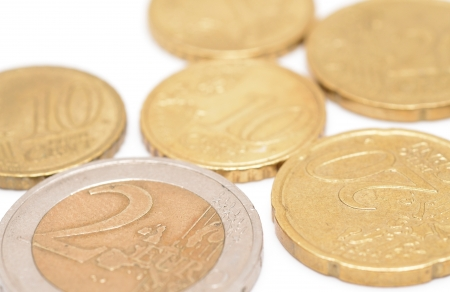 Euro coins placed on the white background  photo