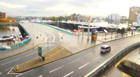 Tilt shift image of city with car on the street  photo