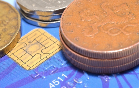 Macro shot of credit card and czech currency, coins