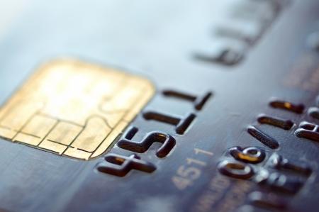 old macro: Low key macro shot with old credit card