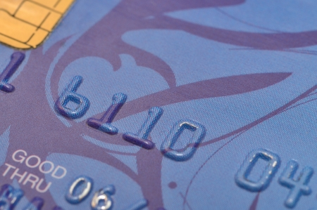 Macro shot of old blue bank card  photo