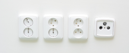 Closeup shot with white sockets and one radio TV socket  photo