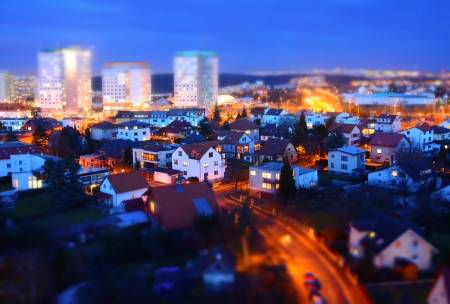 Prague city with big prefabs and houses at twilight with tilt-shift effect