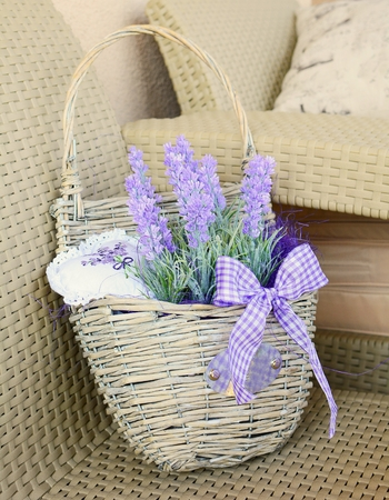 Basket with lavender and ribbon home decoration  photo