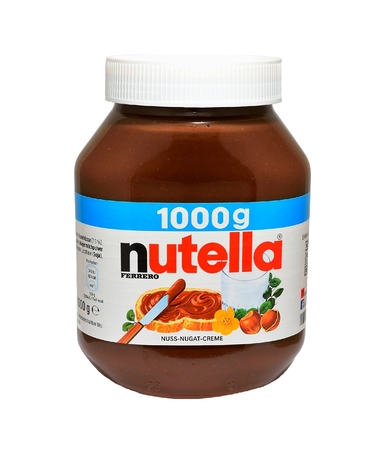 ferrero: PRAGUE, CZECH REPUBLIC - MARCH 23, 2015: Jar with Nutella spread isolated on a white. Nutella is made mainly from hazelnuts and cocoa. It is produced by Ferrero SpA.