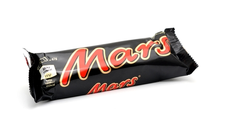 mars incorporated: PRAGUE, CZECH REPUBLIC - MARCH 25, 2015: Wrapped MARS candy bar on a white background. It contains caramel, nougat and chocolate glaze. It is produced by Mars, incorporated.