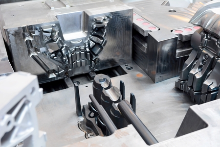 Closeup shot of the machine tool in the factory hall. Stock Photo