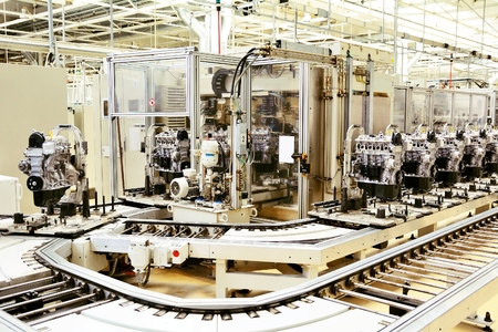 factory automation: Production line for manufacturing of the engines in the car factory.
