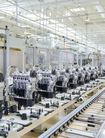 Production line for manufacturing of the engines in the car factory.