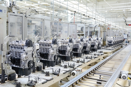 industries: Production line for manufacturing of the engines in the car factory.