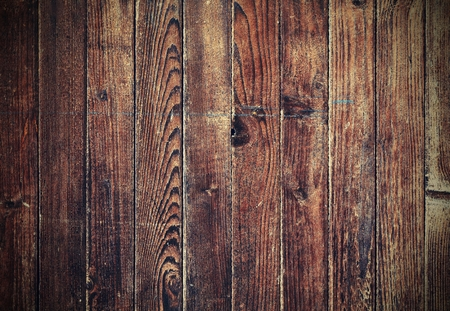 wood panel: Old dark brown wooden texture with retro color effect and vignetting. Stock Photo