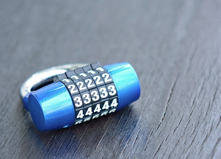 combination: New blue metal combination lock on dark background. Combination lock. Lock. Blue lock. Code lock. Security lock. Metal lock. PIN lock. Stock Photo