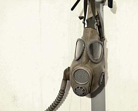 gasmask: Old gas mask hanging on the wall.