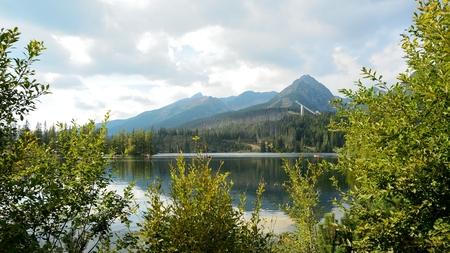 ski jump: View of High Tatras mountains with ski jump from Strbske Pleso lake.