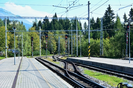 rack mount: Empty platforms without trains and people at terminal railway station Strbske pleso in High Tatras, Slovakia.