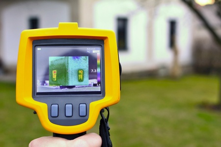 Recording Heat Loss of the House with Infrared Thermal Camera in Hand.