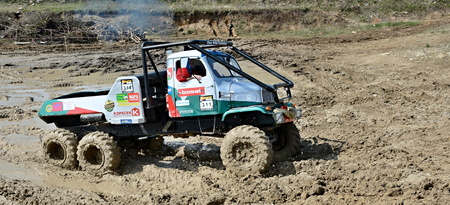 MILOVICE, CZECH REPUBLIC - APRIL 09, 2017: Unidentified truck at difficult muddy terrain during truck trial National championship show of Czech Republic 2017 on April 09, 2017 in Milovice.