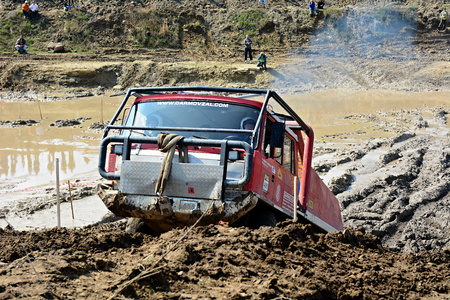 muddy tracks: MILOVICE, CZECH REPUBLIC - APRIL 09, 2017: Unidentified truck at difficult muddy terrain during truck trial National championship show of Czech Republic 2017 on April 09, 2017 in Milovice.