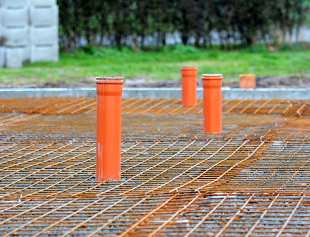 reinforcement: Sewer Pipes Installed in House Foundations. Stock Photo