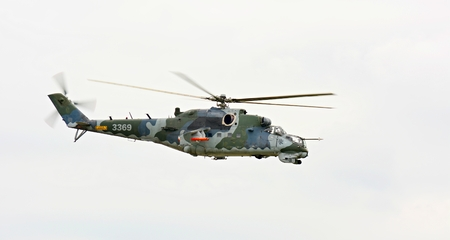 CASLAV, CZECH REPUBLIC - MAY 20, 2017: Exhibition of a large helicopter gunship and attack helicopter Mil Mi-24 in air during the Open Day at Tactical Air Force Base Caslav on May 20, 2017 in Caslav.