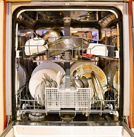 Dirty dishes loaded in a dishwasher.