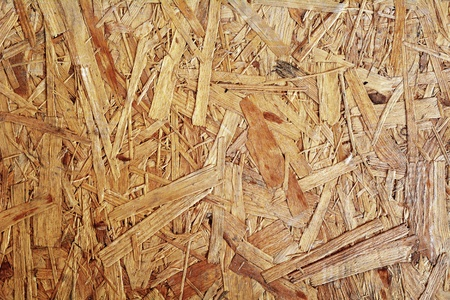 Full frame background shot of a brown chipboard. Stock Photo