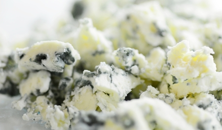 Macro Shot of a Grated Blue Cheese with Visible Cultures of the Mold Penicillium.