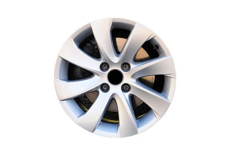 Modern alloy car disk without tire with four screws and brake disk isolated on white background.