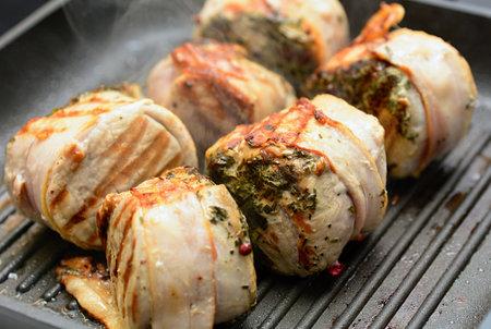 Closeup of pork tenderloin steaks grilling on the pan. 스톡 콘텐츠
