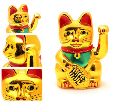 Maneki Neko Japanese lucky cat golden figurine on white 스톡 콘텐츠