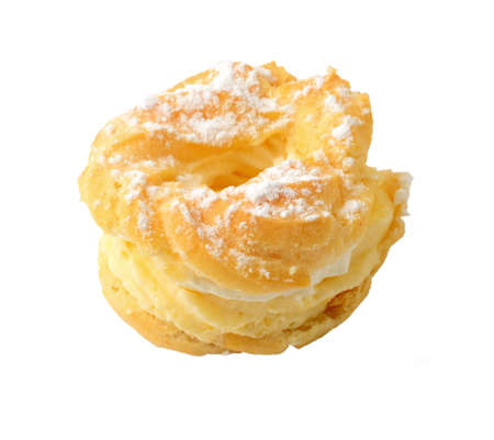 Sweet baked pastry in the shape of wreath with vanilla whipped cream and sprinkled with sugar, isolated over white background. Traditional Czech sweet pastry called venecek.