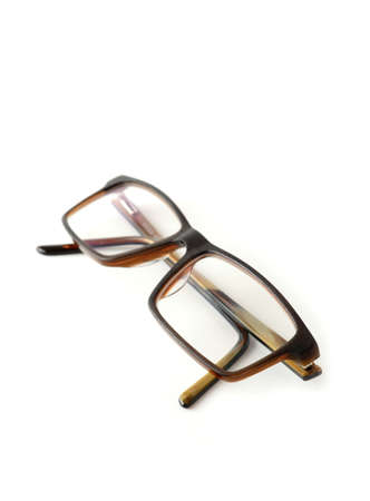 Closeup of folded brown modern eyeglasses on white background.