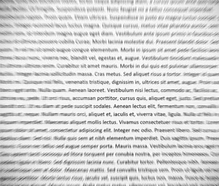 Closeup of lorem ipsum text on white paper, abstract zoom effect. 스톡 콘텐츠