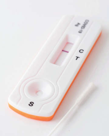 Home antigen test with swab for capturing of  antibodies on white background. It shows negative result.